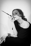 Retro portrait of woman with cigarette Royalty Free Stock Images