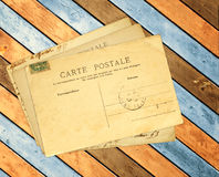 Retro post cards on ancient wooden planks Stock Image