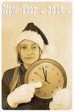Retro postcard - girl in santa claus hat with clock Royalty Free Stock Photos