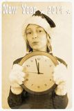 Retro postcard with girl in santa claus hat and clock Stock Image