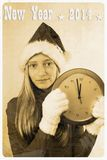Retro postcard with girl in santa claus hat and clock. Vertical Stock Photography
