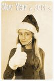 Retro postcard - girl in santa claus hat with headset. Ok sign Stock Photography
