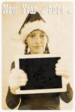 Retro postcard - girl in santa claus hat hold tablet pc. Illustration Royalty Free Stock Photography