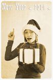 Retro postcard - girl in santa claus hat and show sign Stock Images