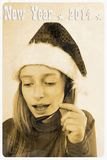 Retro postcard - girl in santa claus hat, speak with headset. Close up Stock Photo