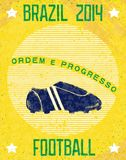 Retro poster Brazil 2014. Vintage football playbill on sunshine background with soccer shoes. Vector eps10 Royalty Free Stock Photo