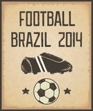 Retro poster on old paper kraft. Vintage shabby poster with inscription, shoes and soccer ball. Football Brazil 2014. Vector eps10 Stock Photo