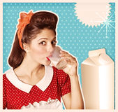 Retro poster.Young woman drinking glass of milk Royalty Free Stock Images