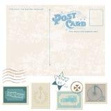 Retro- Postkarte und Briefmarken Stockfoto