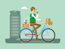 Retro postman on a bicycle Royalty Free Stock Photos