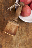 Retro potato masher on old wooden table Royalty Free Stock Image