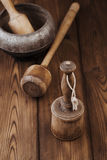Retro potato mashers on old wooden table in rustic style Stock Photo