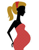 Retro pregnant woman in dotted dress isolated on w Stock Photography