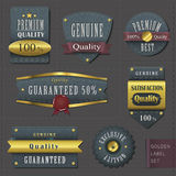 Retro premium quality cloth labels with golden elements Stock Photography