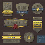 Retro premium quality cloth labels with golden elements Royalty Free Stock Photo