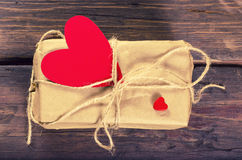Retro present box with red heart Stock Photos