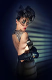Retro pretty woman in black dress and long gloves stock images