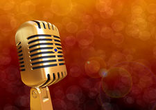Retro priorità bassa dorata del microfono Fotografia Stock Libera da Diritti