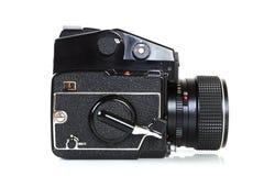 Retro professional medium format camera. Side view - Retro medium format SLR camera from the seventies on white background stock images