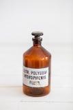 Retro progettazione alla moda antica della bottiglia di vetro Fotografia Stock
