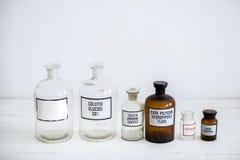 Retro progettazione alla moda antica delle bottiglie di vetro Fotografia Stock Libera da Diritti