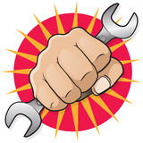 Retro Punching Fist with Spanner. Stock Images
