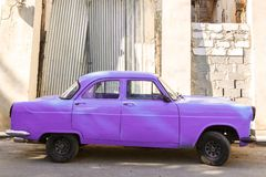 Retro Purple Car Parked in Cuba royalty free stock photos