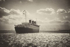 Retro Queen Mary last voyage. An antique looking photograph of the liner Queen Mary leaving New York on its last voyage Stock Image