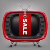 Retro röd tv med labal försäljning Arkivbilder