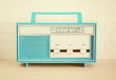 Retro Radio. Retro blue radio on the table Stock Image