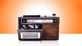 Retro radio and cassette player. On table Royalty Free Stock Image