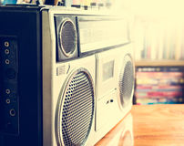 Retro radio cassette stereo recorder on wooden desk. In library royalty free stock image