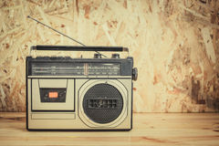 Retro radio cassette stereo recorder on wooden table Royalty Free Stock Images
