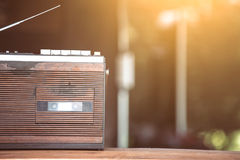 Retro radio cassette stereo on wooden table. In vintage color tone Stock Photography