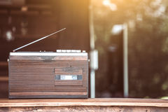 Retro radio cassette stereo on wooden table Stock Photography