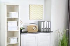 Retro radio on chest of drawers Stock Photo