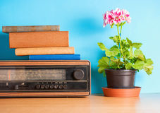 Retro radio with flower and books, vintage still life Royalty Free Stock Photography