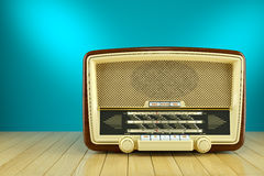 Retro radio receiver on wooden table Royalty Free Stock Photography