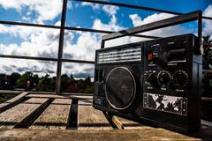 Retro radio. Standing on wooden surface, outdoors Royalty Free Stock Photography