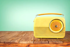 Retro radio on table. With vintage green eye light background - old technology Royalty Free Stock Image