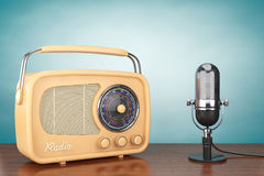 Retro Radio and Vintage Microphone. On the table Royalty Free Stock Photography