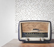 Retro Radio on wooden table. Acoustic board background Stock Image