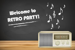 Retro radio on wooden tabletop and chalkboard with copy space Stock Photo