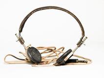 Retro radiohörlurar med mikrofon Fotografering för Bildbyråer
