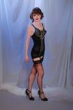 Retro ragazza burlesque sveglia in biancheria Immagine Stock