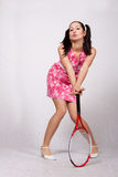 Retro ragazza in un vestito rosa fotografia stock
