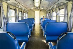 Retro railroad car with one passenger. Retro railroad car, wagon of regional line at South Italy with a single passenger stock images