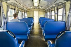 Retro railroad car with one passenger. Retro railroad car, wagon of regional line at South Italy with a single passenger royalty free stock image