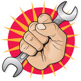 Retro Raised Punching Fist with Spanner. Royalty Free Stock Image