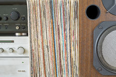 Retro receiver, amplifier stack of vinyl records near the sound speaker. Retro receiver, amplifier, turntable and stack of old vinyl records near the big wooden royalty free stock photos